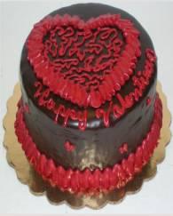 Dark chocolate valentine cake with red heart cake decoration